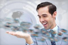 Pleased businessman looking at a picture whirl - stock photo
