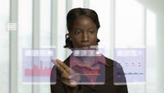 African American Woman operating touchscreen business interface Stock Footage