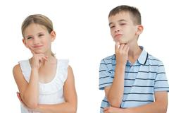 Thoughtful brother and sister posing together - stock photo
