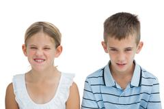 Stock Photo of Furious brother and sister posing together