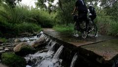 Cycling across the water Stock Footage
