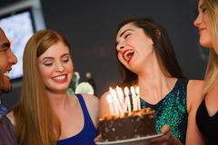 Cheerful friends celebrating birthday together Stock Photos