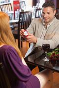 Handsome man making marriage proposal Stock Photos