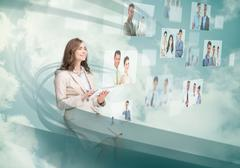Stock Photo of Smiling businesswoman using digital interface