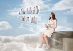 Businesswoman using futuristic interface - stock photo