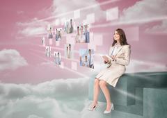 Stock Photo of Smiling businesswoman using futuristic interface