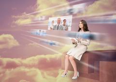 Stock Photo of Pretty businesswoman using futuristic interface