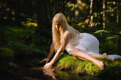 Stock Photo of woman on creek