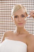 treatment with brush - stock photo