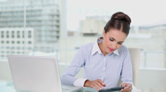 Stock Video Footage of Young businesswoman making calculations