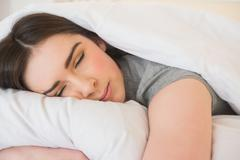 Stock Photo of Calm girl sleeping in her bed