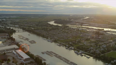 Aerial sunset sun flare view of log booms Fraser River  Vancouver Stock Footage