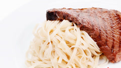 Stock Video Footage of italian cuisine : grilled beef steak with pasta