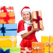Cheerful christmas woman with presents Stock Photos