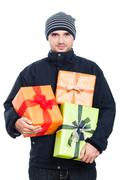 Winter man with presents Stock Photos