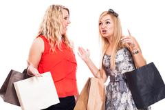 Stock Photo of excited girls shopping and talking