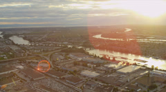 Aerial sunset sun flare view of log booms Fraser River  Vancouver - stock footage
