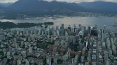 Aerial dusk view over Vancouver City Harbour  Stock Footage