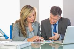 Two content business people trying to understand figures Stock Photos