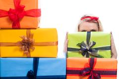Stock Photo of secret woman hiding behind presents