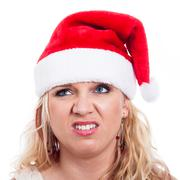 Disgusted christmas woman face Stock Photos