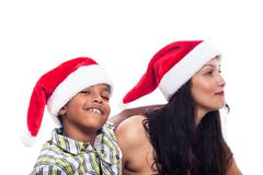 Happy family in christmas hat Stock Photos
