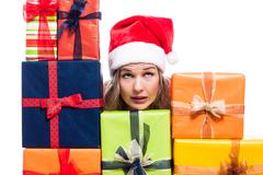 Stock Photo of christmas woman with presents looking up