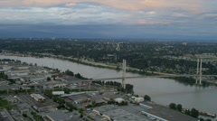 Aerial sunset view Alex Fraser Bridge on Annacis Island, Vancouver Stock Footage