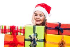 Pleased christmas woman with presents Stock Photos