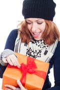 Exited woman opening present Stock Photos