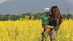 Beautiful picture, young mother with long hair in the wind hold in arm cute baby Stock Footage