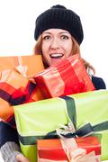 Ecstatic woman with many presents Stock Photos