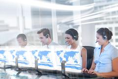 Stock Photo of Call center employees at work on futuristic holograms