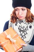 unhappy woman with present - stock photo