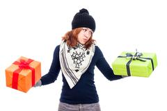 indecisive woman holding gifts - stock photo