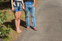 Legs of couple going for a trek together - stock photo