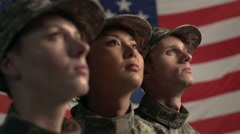 3 soldiers in front of American Flag Close Up Stock Footage