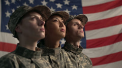 3 soldiers in front of American Flag Medium Shot - stock footage