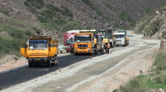 Chinese road crew working abroad, development assistance in Central Asia Stock Footage