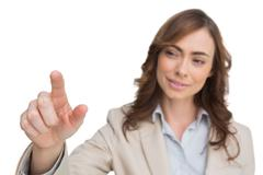 Businesswoman touching invisible screen Stock Photos