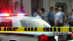 Diverse group, defocused, confer at real Crime Scene. Stock Footage