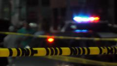 Crime scene Police Tape; bg soft focus, night, urban Stock Footage