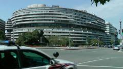 Watergate Complex EWS, cars pass Stock Footage