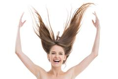 Laughing pretty woman throwing her hair up Stock Photos