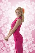 pretty blonde girl with pink dress - stock photo
