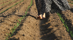 Shoesless lady feet pass over spring fertile ground, barefoot lady walking  Stock Footage