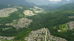 Aerial view residential homes in valley communities, Canada Stock Footage
