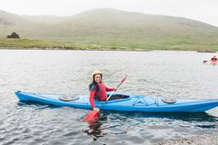 Stock Photo of Smiling woman in a kayak