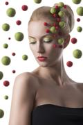 girl with colored spheres on the face - stock photo
