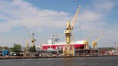 Harbor cranes, shipyard and docks in Szczecin, Poland Stock Footage